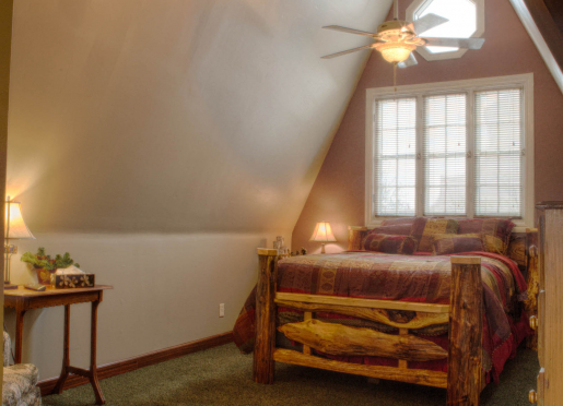 ASPEN ROOM - Located on the 3rd floor, the hand crafted rustic log bed provides masculine decor.