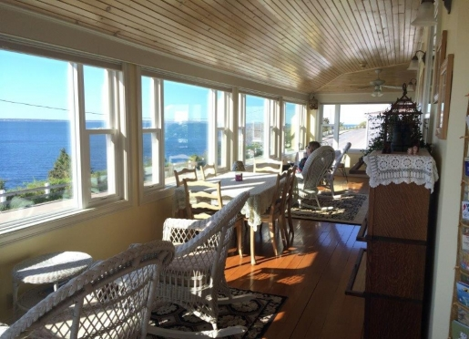 Baileys wraparound oceanfront porch is a great place to enjoy the gourmet breakfast or just relaxing