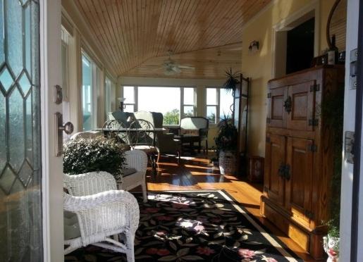 Enter Baileys to a wraparound porch with expansive ocean views