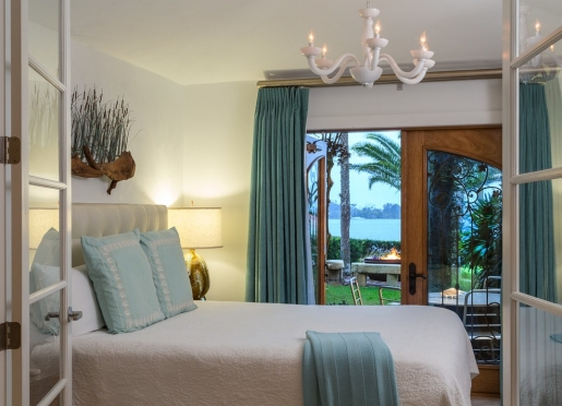 Bay View Suite on the first floor level overlooking the fire pit feature and Indian River Lagoon.