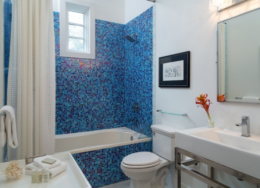 Our spa-inspired bathrooms are wrapped in glass mosaic tile.