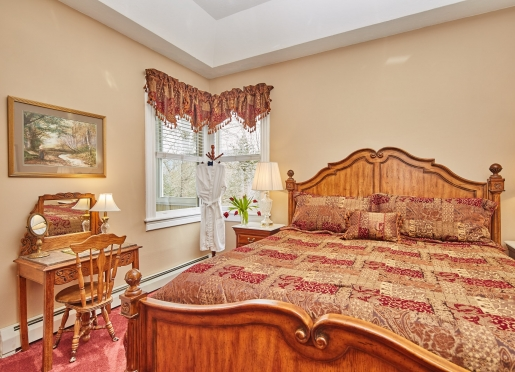 The comfortable king sized bed in the Magnolia Suite