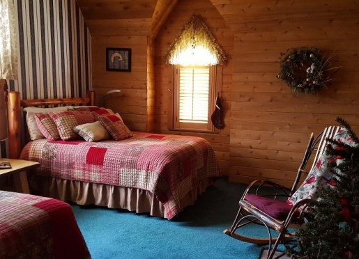 Our Northern Woods room with two large cedar log beds for friends who travel together.