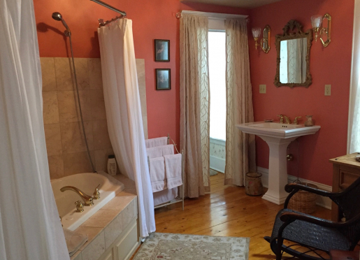 Summer Suite bath features double whirlpool with shower