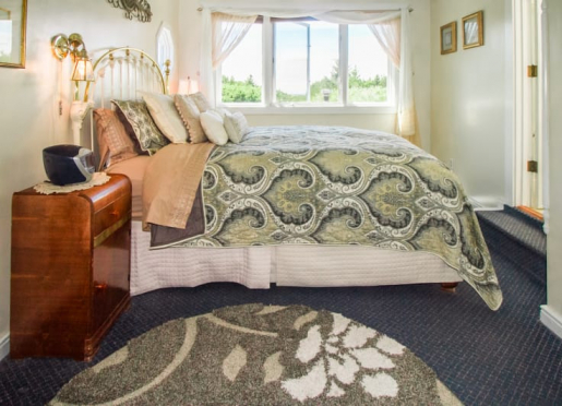 The lovely Stargazer room has a sweeping dunes and ocean view.