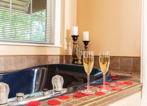 HONEYMOON SUITE - Private bath features an over-sized tub big enough for two, as well as a shower.