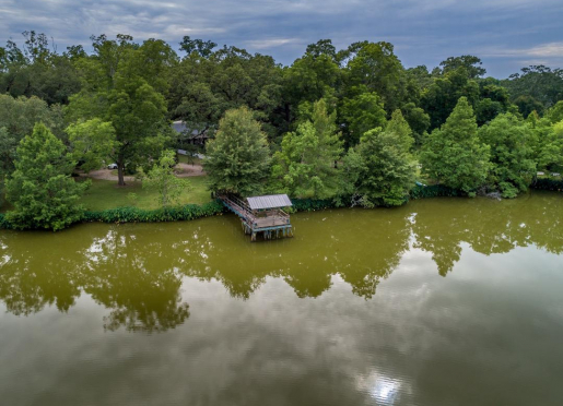 Hidden in the country on a private pond